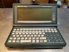 HP 200LX palmtop with correct power supply F1011 and connectivity cable works!
