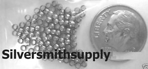 18kt White gold plated 2x1.5mm round crimp beads 100 fps015