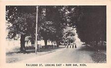 BURR OAK MICHIGAN RAILROAD STREET POSTCARD c1947 CHILDRENS ON BIKES WITH DOG