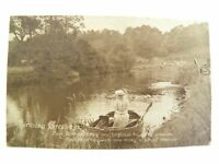 Antique printed postcard Birthday Card lady in a row boat on river landscape