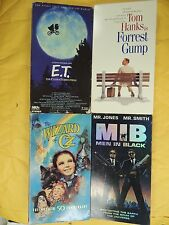 4 Box-Office Hits VHS movies: E.T., Forrest Gump, The Wizard of Oz, Men In Black
