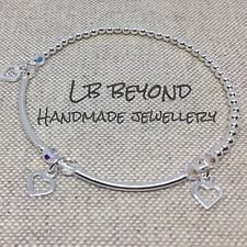 STERLING SILVER BEADED STRETCH STACKING BRACELET WITH OPEN HEART CHARMS 925