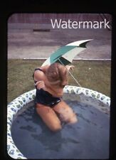 1960s 35mm half frame photo slide lady in swimming pool hiding face