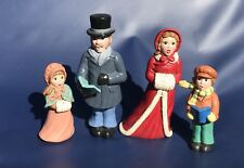 "Christmas Carol Family Figurines Mom Dad Son Daughter Singing Up To 9.5"" Tall"