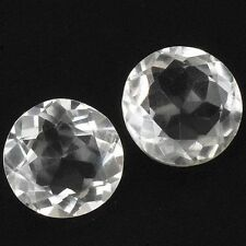 A PAIR OF 6mm ROUND-FACET NATURAL BRAZILIAN WHITE QUARTZ GEMSTONES