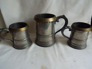 Excellent antique set of 3 pewter & brass tankards by Farmiloe & Sons London.VR