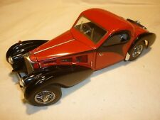 A Franklin mint scale model car of a 1936 Bugatti type 57SC Roadster
