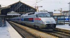 PHOTO  A TGV WAITS TO DEPART FROM MARSEILLE ST.CHARLES 2004