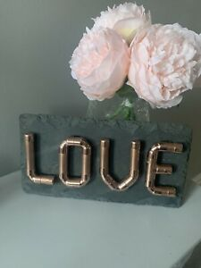 Handmade Industrial Look Copper Pipe Letters LOVE Sign Mounted on Grey Slate