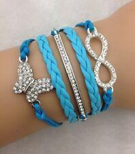 Bracelet  bleu turquoise papillon en strass et lien infini en strass