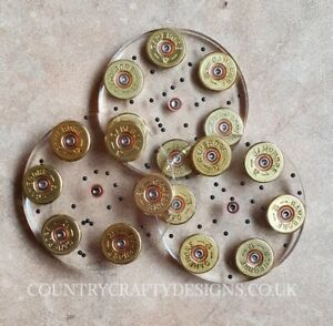Shooting themed resin coasters made with used shotgun cartridge brass