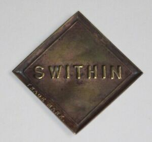 SWITHIN - Antique Brass Plaque-Shipping/Packaging Label, Glue Brand?