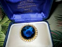 Charming vintage faceted sapphire blue glass brooch