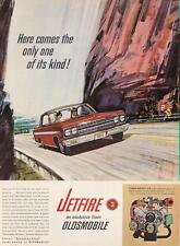 1962 Oldsmobile PRINT AD features illustrated red Jetfire mountain detailed pic