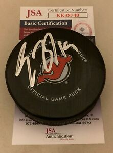 Travis Zajac signed New Jersey Devils Official Game Puck autographed JSA