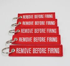 REMOVE BEFORE FIRING KEYCHAIN - RED/WHITE LETTERS - GUN GLOCK HK S&W BERETTA