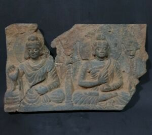 A GANDHARA STONE FREEZE WITH 2 SEATED BUDDHAS.