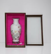 A Famille Rose'Flower and Insect' Vase