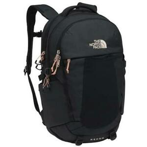 The North Face Women's Recon Backpack in TNF Black Heather/Burnt Coral Metallic