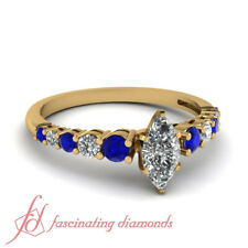 .90 Ct Graduated Round Diamond And Sapphire Engagement Rings With Marquise Cut
