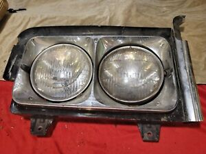 OEM 1970 Cadillac Fleetwood special 60 complete headlight assembly cracked