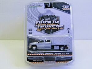 1/64 Dcp/Greenlight silver Chevrolet 3500 crew cab flatbed truck new.
