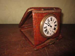 An old crocodile skin folding travel clock