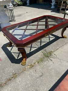 Wooden Coffee Table with Gilded Claw Feet and Accents, Glass Top