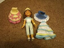 Dora's  teenage sister w clothing and quincenero cake