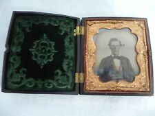 DAGUERREOTYPE PHOTO OF A YOUNG MAN IN A DETAILED GUTTA PERCHA CASE