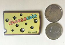 * Cheesocoin Swiss Cheese Geocoin Shaped SE Unactivated