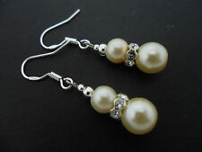 A PAIR OF IVORY COLOUR GLASS PEARL  EARRINGS WITH 925 SOLID SILVER HOOKS. NEW..