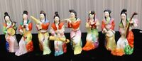 Vintage porcelain figures playing traditional Chinese musical instruments