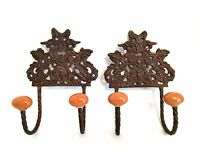 Two Cast Metal Ornate Wall Mount Hooks Hangers Ceramic Knobs 6.75 inches