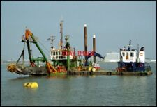 PHOTO  THE BOAT BROUGHT IN TO DREDGE CARDIFF BAY AFTER THE COMPLETION OF THE BAR