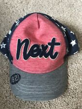 BNWOT Next Peaked Baseball Cap. Unisex. Age 3-6 Months. Navy/ Blue/ Red Stars
