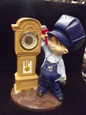 Ceramic statue clock featuring mechanic and grandfather clock (non-working)