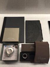 A Lange Sohne watch speaker Glashutte Original loupe polish cloth leather diary