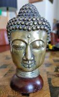 Tête de Bouddha en bronze sur socle en bois