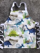TODDLER'S PVC PLASTIC WIPE CLEAN CRAFT/COOKING APRON DINOSAURS. IDEAL GIFT