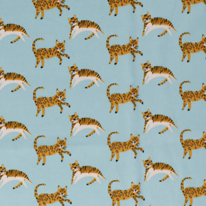 Bauwollstoff Dappe mint mit Löwen