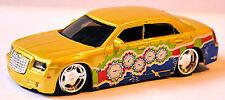 Chrysler 300C 6.1 Hemi-V8 SRT8 2005-10 Street Tuners gold metallic 1:43 Bburago