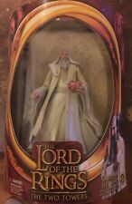 Lord Of The Rings Two Towers Saruman The White with staff-raising action