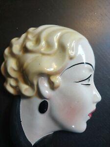 Art deco wall face mask