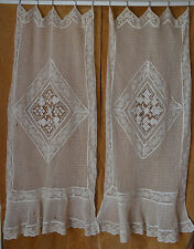 A pair of antique French net and needle lace curtains, beautifully time worn