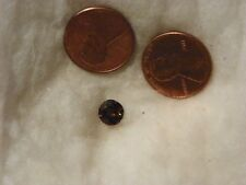 Kornerupine 1.40 Carats 7 MM. Round x 4.21 Slight Natural Inclusions Eye Clean