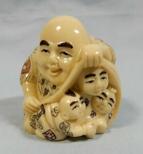 Vintage Japanese netsuke monk with children unused old stock