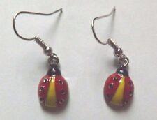 Boucles d'oreilles argentées coccinelle rouge, jaune et noir 17x10 mm