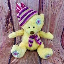 Posh Paws yellow Teddy bear soft toy wearing Hat & Scarf flowers on feet & head