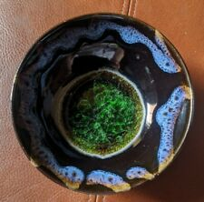 Antique Chinese tea bowl with black & blue drip glaze & green silver crystalline